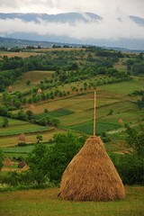 Romanian haystack--popular subject for us (DSLEWIS) Tags: countryside farm country farmland haystacks romania farms hay maramures