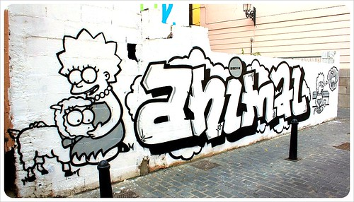 valencia street art lisa simpson save animals