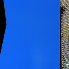 Reach (Lord Jezzer) Tags: blue shadow color lines yellow architecture silver buildings dark angle space gap minimal negativespace reach colorphotoaward misattributedbrowningquote