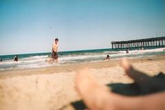 skim boarding (bmeeee) Tags: ocean film pier fishing sand waves minolta virginiabeach skimboarding