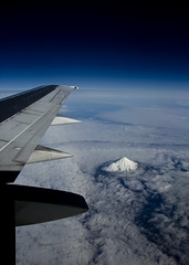Over Mt Taranaki (Tim Bow Photography) Tags: blue newzealand sky cloud mountain snow weather clouds dark landscape fly flying horizon flight wing aerial clear british welsh cloudscape svenska mounttaranaki stickingout tumblr psdtuts timbowphotography