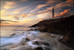 Ardnamurchan Lighthouse (angus clyne) Tags: world ocean new old uk blue light red cliff cloud sun seascape storm west beach water rain rock stone silver dark landscape island shower gold grey islands bay coast scotland high long exposure angle