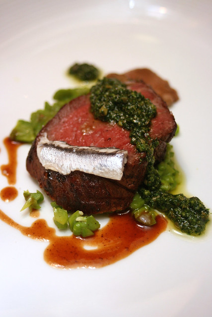 Tuscan Style Dry-Aged Ribeye, with Wild Mushrooms, Taggliasca Olives, Fava Beans and Sauce Salsa Verde