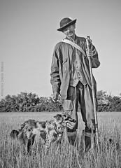 Pásztor (Hungarian shepherd) (DavDesign: David Berkes) Tags: bw dog white david black nature canon eos shepherd human ember kutya természet magyar hungarian berkes fekete fehér 400d davdesign wwwdavdesignhu pásztoir