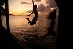 (Micah Camara) Tags: ocean sunset sea silhouette swim hawaii pier jump kauai hanalei