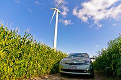 Earth & Machine. (Rares M. Dutu) Tags: world blue green cars clouds illinois corn nikon energy angle wind compton farm air tripod wide super tokina generator prius farms hybrid hue f4 windfarm renewable 1224 worldcars d7000 122mb 4928x3264