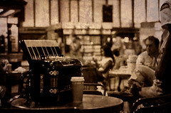 The Relationship: Music & Coffee (FarCorner) Tags: old people music woman usa man classic film coffee station boston sepia train vintage table ma 50mm reading chair nikon waiting decay security nikkor 18 southstation wornout malden d300 صورة جدة ناس قديم انتظار قهوة رياض سعودية كرسي موسيقي دمام ظطاولة