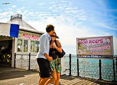 Its Fun All Year on Brighton Pier (Lilla~Rose) Tags: uk boy sea summer vacation holiday colour love ice beach girl sunshine vintage sussex coast pier seaside couple brighton candid cream pop milkshake deckchairs moomoo brightonpier sunnydays brightonrock weekendshowcase