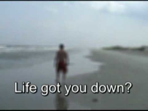 Still from a Prozac ad, showing a blurred, sad person on the beach with caption 'Life got you down?'