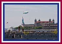STATUE OF LIBERTY AND ELLIS ISLAND (NC Cigany) Tags: history statue docks pier boat smog newjersey rust waterfront flag nj helicopter american blimp fujifilm hudsonriver statueofliberty period ellisisland newyorkharbor portofnewyork 8777