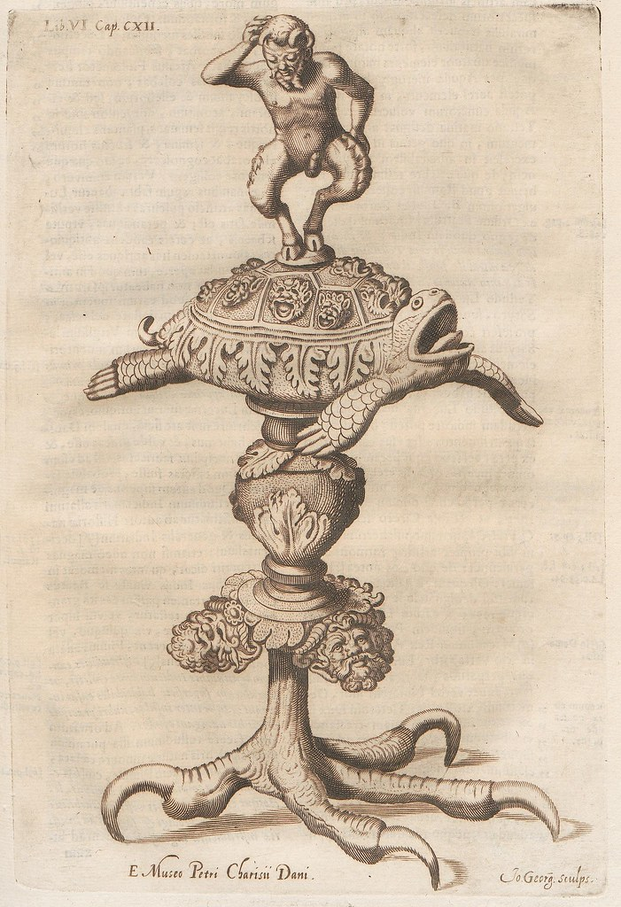 table stand design: satyr atop turtle atop eagle-clawed base
