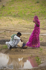 Water is Life (Iqbal.Khatri) Tags: life travel pakistan woman man water rain rural pond couple culture lifestyle crop fields agriculture utensil sindh filling thar rurallife iqbal khatri tharparkar parkar tharri