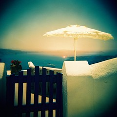 Santorini (saviorjosh) Tags: door travel flowers blue sunset red sea sky white holiday green wall fence island holga xpro mediterranean kodak toycamera plasticfantastic 64 santorini greece parasol crossprocessing expired ektachrome plasticlens epr iso64 may2011