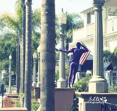 Get Your Morphsuit On (lizbeth ) Tags: voyage california street trip travel viaje building tree palms eli purple sandiego flag bikes paseo coronado avenue viewpoint lvm lavueltaalmundo gentedeespaldas morphsuit seliphotography letouraumonde elizabethssecret