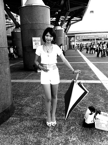 Umbrella girl outside the convention hall