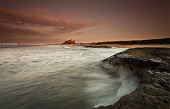 Bamburgh Sunset (.Brian Kerr Photography.) Tags: sunset sky seascape motion castle beach clouds canon landscape rocks waves northumberland coastal coastline bamburgh eos5dmkii briankerrphotography