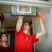 Jared Demorat, right, and Matt Frank get their basketball goal up and running in Lee Hall.