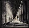 haunted by the past.. (PNike (Prashanth Naik)) Tags: longexposure light shadow people building sepia architecture walking temple nikon asia cambodia corridor blurred angkorwat angkor wat pillars d7000 pnike