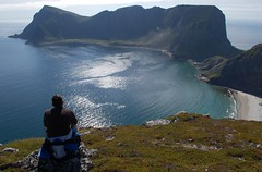 In paradise  (~Ranveig Marie~) Tags: mostad mstad vry behind lofoten lofotenislands nordland mountain cliff view landscape sea ocean island clouds sky horizon atlanticocean edge man people guy person sitting stone rock nature norsk natur norwegen norway noruega norwegian nordnorge northernnorway travel traveling hiking summer weather sunshine grass beach scandinavia skandinavia watching hike tur fottur norvge europe walk naturewalk himmel friluft images pictures photos ranveigmarienesse ranveignesse fjelltur pics photographs visitnorway paysage outdoors bilder hen utsikt photography