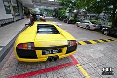 Colourful Singapore (celsydney) Tags: street cars mercedes singapore hilton automotive porsche spotted wealthy dtm lamborghini gt2 amg exotics murcilago valet clk 997