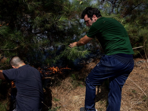 Greek volunteers fighting forest fire outside country's second largest city, Thessaloniki