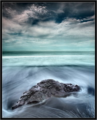 Lone Rock - Rodeo Beach (Tony Immoos) Tags: ocean california longexposure sky motion water sunshine rock clouds movement sand surf pacific postcard wide scenic wideangle olympus explore marincounty e3 seashore ultrawide saltwater daytrip circularpolarizer rodeobeach cokin californialandscape zd nd8 ndgrad zuikodigital p121f olympuse3 918mm