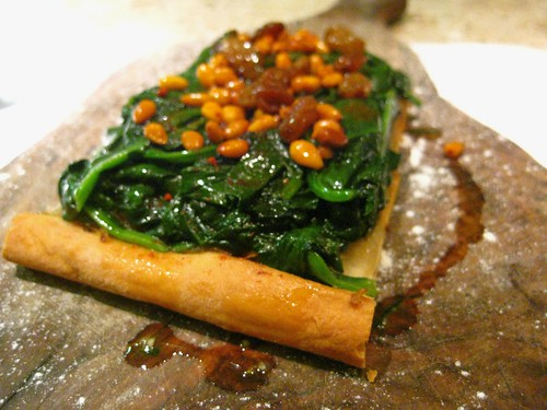 Coca Mailorquina with spinach, pinenuts and sultanas