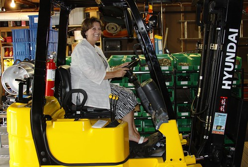 USDA Rural Development's State Director checks out one of two new forklifts at ProWorks, Inc. in Litchfield, Minn.