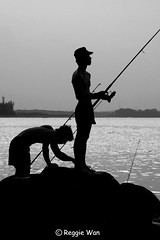 Their game is fishing, ours is shooting them. (Reggie Wan) Tags: silhouette fishing singapore asia southeastasia punggolbeach reggiewan sonya850 sonyalpha850 gettyimagessingaporeq1