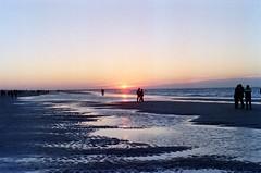 Scheveningen beach 1 (Kjell_Doggen) Tags: winter sunset sea portrait film beach strand 35mm 50mm gold zonsondergang md colours minolta kodak zee negative shore 400 end 700 portret kust x700 kleuren f17 2011 plustek opticfilm