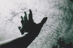 She tried to touch the fleecy sky (SoWiL(d)) Tags: sky cloud analog 35mm blackwhite hands dream