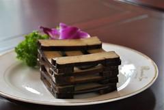 doufu stack (Ian Riley [on the right side of the fence]) Tags: china food asia tofu chinese stack beancurd shanxi smoked doufu taigu
