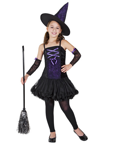A young girl in a 2011 Witch Costume, complete with corset and lace arms. She is standing with her arm on her hip
