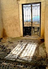 Santorini ps16 (Samothtitep) Tags: shadow metal architecture gates decay santorini greece walls arcitecture cobbles crumbling rundown fira