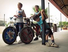 Belek Boys (Schorli_Carla) Tags: city travel light shadow people urban art colors childhood bike youth canon turkey children faces expression turkiye young powershot antalya whore g11 belek