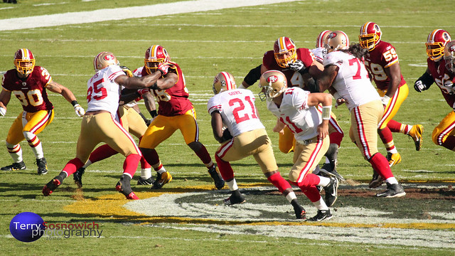 QB Alex Smith hands off to RB FRANK GORE.