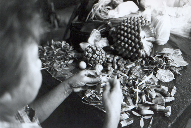 Tongan Woman making a lei