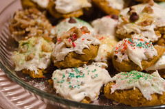 Pumpkin Spice Cookies (decorated by the kids!) (Truebritgal) Tags: thanksgiving autumn ohio fall cookies up closeup pumpkin dessert nikon colorful cookie dof close sweet spice seasonal walnuts glaze handheld tray treat colourful frosting decorated sprinkle dragee wintersville d7000 tamronspaf1750mmf28xrdillvc truebritgal