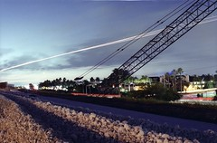 Cranes Are Cool At Night! (Burnt Umber) Tags: light urban abandoned film 35mm painting florida miami explore pentaxk1000 interstate 135 expired kodak400cn ue urbex 826 836 ©allrightsreserved dolphinexpressway palmettoexpressway flurbex tamronsp3580f28 rpilla001