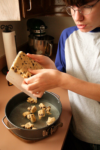A.J. making the cookie dough crust.