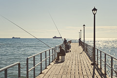 Limassol days (Allard One) Tags: november autumn sky people seascape fall sunshine clouds strand reflections island pier fishing nikon sitting jetty ships country herfst relaxing cyprus zee eurasian vissen mediterraneansea oldmen eiland 22degrees limassol yearning mensen lampposts againstthesun livingthedream steiger ouderwets 2011 kbrs fishingrods limasol zonneschijn easternmediterranean hengels lantaarns middellandsezee nikcolorefexpro seaships spaarlampen d700 mediterraans leymosun kpros republicofcyprus nikond700 nikkor2470mmf28 lemess  nikonfx vintagepp kypriakdmokrata zeeschepen  allardone allard1 gpsrecorder kbrscumhuriyeti oudemannetjes totallyradactionmix2therevenge fullframepower  southeasternmost zuidoostelijkst allardschagercom