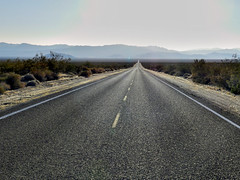 Long Road Through the Mojave (TheJudge310) Tags: california road street cali highway glow desert mojave sanbernardino nationalpreserve