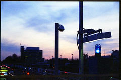 blue light sunset (Beaulawrence) Tags: blue winter light sunset sky canada color colour slr film station vancouver clouds analog train 35mm subway lens march mar reflex lomo lomography skies bc grain platform columbia richmond scan line negative single transit british 135 elevated evidence skytrain translink rapid 2012 landsdowne mz50 c41 unbranded pentaz sooc