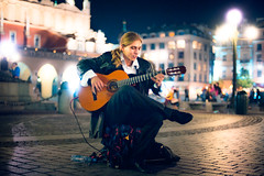Guitar (TGKW) Tags: boy portrait people musician playing man night hair square lights long sitting market bokeh guitar tail main krakow player pony blonde nightlife guitarist rynek gwny 7033
