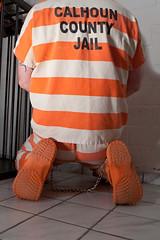 Calhoun_6401 (skinmate) Tags: uniform prison jail shackles prisoner inmate restraints legirons