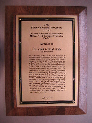 A photograph of the Colonel Rohland Isker Award given to the USDA/AMS Rations Team.  Members of the USDA staff are being recognized for their efforts to ensure only top quality products reach our troops.