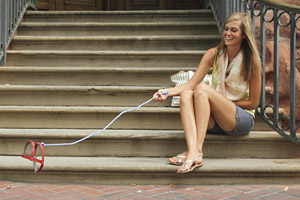 Invisible Dogs campaign photo showing a woman with an invisible dog on a leash