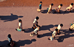 my first lesson on friendship!! [Explored 08-11-2011 #75] (swarat_ghosh) Tags: school friends shadow india students kids children asian interesting nikon uniform asia friendship explore 1855mm karnataka topview bidar hws explored d3000 swaratghoshphotography