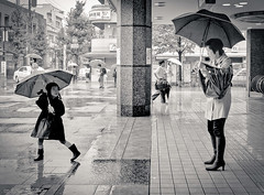 Typhoon girl (drichi2006 (slow, like the new Flkr)) Tags: people urban blackandwhite rain weather japan tokyo   typhoon denenchofu    m43   japaninbw microfourthirds lumix20mm17 olympuspenep3 typhoon15