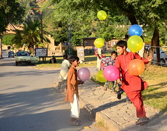 Joy of getting a balloon: Priceless (Amima Sayeed) Tags: poverty pakistan childhood rural balloons